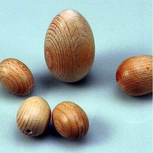Billigtpyssel.se   Trä ägg 25 x 30 mm ø 3 mm - 25-pack - blekt halvhål